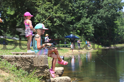 Emma Ross, 7, of Butler waits for a fish to bite on her line with her sister Brooklyn, 4, during Concordia's Kids Fishing Days Saturday at Saxony Farm Estates. Seb Foltz/Butler Eagle 07/26/20