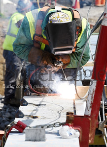 Harold Aughton/Butler Eagle: A welder from Gregory Construction in Saxonburg welds the decking on to the new bridge in Chicora, Tuesday, July 28, 2020.