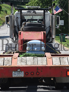 Harold Aughton/Butler Eagle: Mark Thomas takes his life-long friend Todd Urban to his final resting place in his tractor trailor truck.