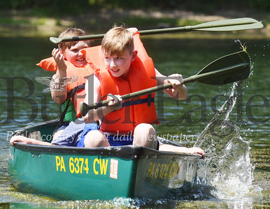 Harold Aughton/Butler Eagle: Carter Farren and Tyler Blair race across the pond at the Petroleum Valley Youth Camp, Wednesday, July 29, 2020.