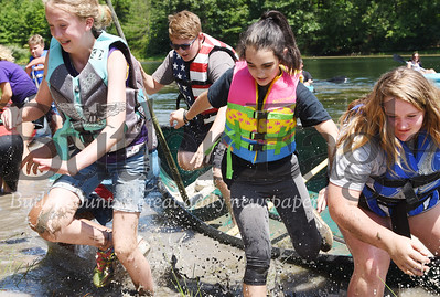 Harold Aughton/Butler Eagle: Raegan Schmoll, Ashley Huff and Braylynn Thompson exit their canoe during a race a the Petroleum Valley Youth Camp, Wednesday, July 29, 2020.