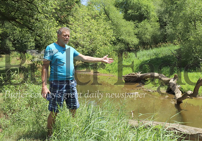 Joe Marcus describes garbage and errosion issues on Thorn Creek. According to Markus, log jams have caused creek errosion along a nearby road. Flooding also brings garbage onto his property.  Seb Foltz/Butler Eagle