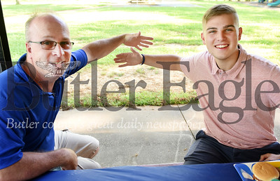 Harold Aughton/Butler Eagle: Freeport High School math teacher Sam Frishkorn, left, air huggs graduate Sam Blair during the school's Top Ten celebration Tuesday, June 2, 2020. Blair will major in Mechanical and Areo Space Engineering at West Virginia University in the fall.