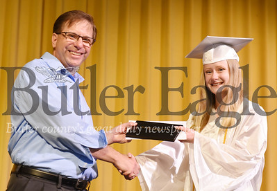 Harold Aughton/Butler Eagle: Hannah Lindell choose to receive her diploma from her father John Lindell.