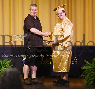 Harold Aughton/Butler Eagle: Butler graduate Cannon Plyler choose to receive his diploma from his dad, Donald Plyler.