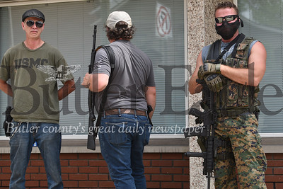 Armed men on Saxonburg's main commercial street on Wednesday.
