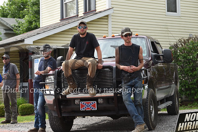 From left: Dusten Whitacre, 22, of Cabot, Ryan Kitzky, 22, of Penn Township and Cory Frye, 28, of Kittanning sit on a truck in Saxonburg on Wednesday.