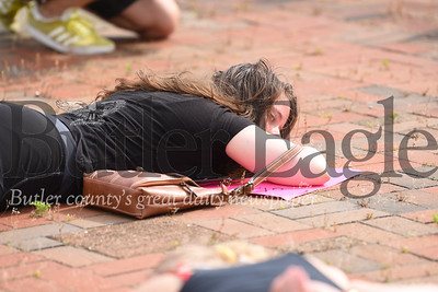 Frances Martin, 22, of Saxonburg lies down on the ground during a Wednesday protest against the police killing of a Minneapolis man named George Floyd.Frances Martin, 22, of Saxonburg lies down on the ground during a Wednesday protest against the police killing of a Minneapolis man named George Floyd