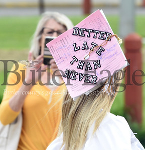 Harold Aughton/Butler Eagle: Natalie Marburger put a unique spin on her graduation by decorating her cap with all of the late hall passes she had accumulated over the years.