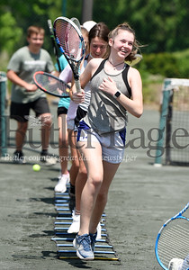 Harold Aughton/Butler Eagle: Kensie Gumto of Renfrew runs the ladder drill with other tennis students at the Butler Country Club, Wednesday, June 3, 2020.