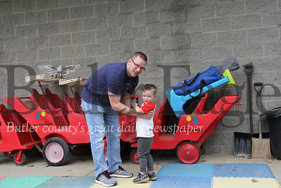Chad Danik, 36, picks his son, Chase, up from Small Impressions Child Care In Saxonburg. The day care opened on Monday.