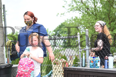 On left, Melissa Colajezzi of Saxnburg picks up her 5-year-old Lillianna-Kay from Small Impressions Childcare as they speak with Brooke Casey, 22 of Saxonburg.