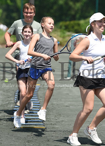 Harold Aughton/Butler Eagle: Tennis students run the ladder drill prior to practice at the Butler Country Club Wednesday, June 3, 2020.