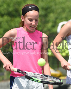 Harold Aughton/Butler Eagle: Ele Cassidy warms up prior to practice at the Butler Country Club, Wednesday, June 3, 2020.