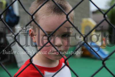 Chase Danik, 3, waits for his father to pick him up from Small Impressions Child Care In Saxonburg. The day care opened on Monday.