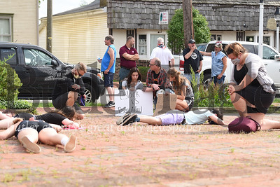Around a dozen people in Saxonburg Wednesday rest face down on the floow to represent the police killing a Minneapolis man named George Floyd. photos by Eric Jankiewicz