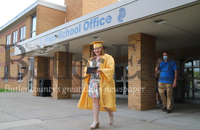 Hannah McCune walks out of Knoch High School after graduating. Seb Foltz/Butler Eagle