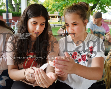 Harold Aughton/Butler Eagle: Sisters Natalie, 16, and Julia, 12, Mason of Butler light candles during a memorial service held in Rotary Park honoring the memory of George Floyd Tuesday, June 2, 2020.