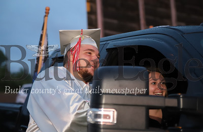Slippery Rock High School senior Curtis Franco watches  ceremonies on screen before walking at graduation at the Starlight Drive-In Thursday. Seb Foltz/Butler Eagle
