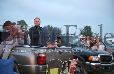 Christian Franco sits on his truck ready to watch his brother Benjamin Franco graduate at Slippery Rock High School's ceremony at the Starlight Drive-In Thursday Night. Seb Foltz/Butler Eagle