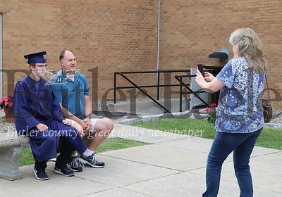 Aaron Plyler sits for a photo with his father at Knoch graduation. Seb Foltz/Butler Eagle