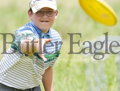 Harold Aughton/Butler Eagle: Max Mayo, 13, of Butler joined his friend William Hendrix, 12, of Butler for a game of Frisbee golf at Harcrest Community Park, Wednesday, June 3, 2020.