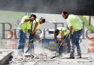 Harold Aughton/Butler Eagle: Wayne Geibel and Cory Geagan operate the jackhammers while Zach Korder and Tom Stoughton of the Butler Public Works department  remove concrete from the Monroe St. Bridge, Tuesday morning, June 9, 2020.