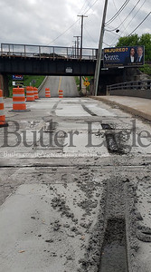 Monroe bridge 1 &2  ---Tire marks are seen on the Lookout Bridge on Monroe Street where witnesses say a driver drove through wet cement on May 27.