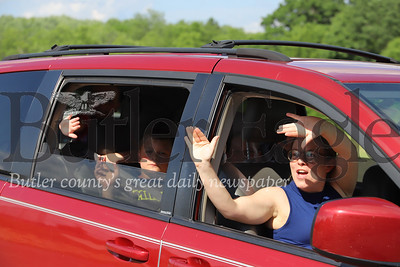 Members of the Trepanier family wave to staff at Camp Apple's drive-thru camp kickoff event Wednesday afternoon. Seb Foltz/Butler Eagle