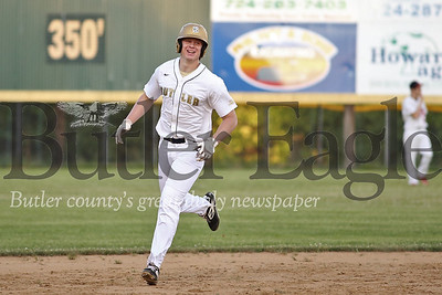 Butler's Kyle Weitzel (24) rounds the bases after hitting a grand slam in the first  inning of Thursday night's game against East Butler.  Seb Foltz/Butler Eagle