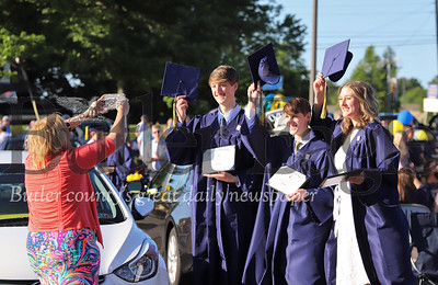 Triplets Austin(left), Grant and Reagan Lloyd pose while their mother Linnae Lloyd snaps a photo at Mars Area School District graduation Friday. Seb Foltz/Butler Eagle 061220