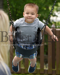 Harold Aughton/Butler Eagle: Kane Strayhorn,2, of Cranberry watches his mother, Christin as he takes a ride on the swings at the Cranberry Twp. Community Park, Monday, June 15, 2020.