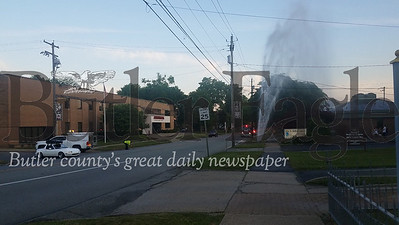 A geyser gushed from a water main break across the street from the Armstrong customer service center building located at 437 North Main Street in Butler Monday, June 15, 2020. photo 2