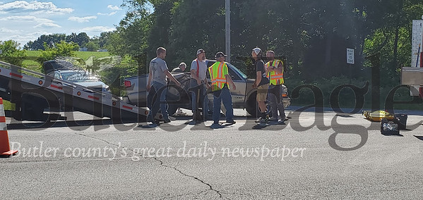 An accident on Route 8 sent two riders of a motorcycle to the hospital after they collided with the side of a truck. Nathan Bottiger/Butler Eagle photo 1