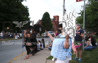 Around 100 protesters lined the street corners at the intersection of Grandview Ave and Route 19 in Zeilienople Park Wednesday evening for a candle light vigil promoting the Black Lives Matter movement. Seb Foltz/Butler Eagle