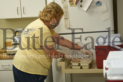 9508 -- Karen Peterson packs meals on Friday for the Meals on Wheels program in Connoquenessing Township.
