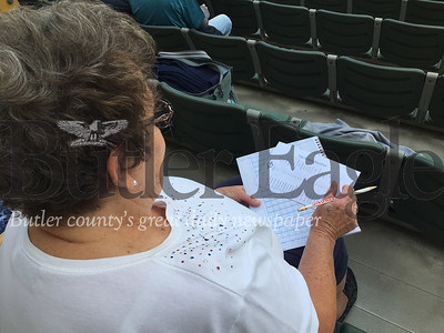 Cutline: Doris Williams prepares her scorebook while waiting for the start of a Butler BlueSox game against the Butler Iron Bucks at Pullman Park.Derek Pyda photo 0619_spo_pullman4