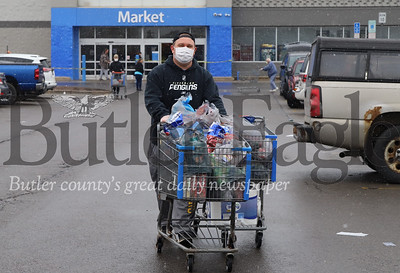 Dan Powers of Zelienople stocks up on groceries at Walmart in Butler Friday.  Walmart has been limiting the number of people in the store at a single time in order to reduce the risk of spreading COVID-19. Starting this week the state of Pennsylvania will require shoppers to wear masks at all times in stores. Seb Foltz/Butler Eagle