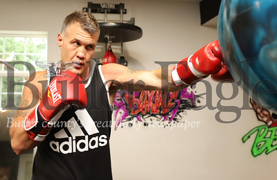 Retired pro boxer Brian Minto warms up with a punching drill in his home gym Tuesday. Seb Foltz/Butler Eagle 06/23/20