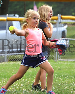 Calie Herman, and Danica McLay practice their throwing skills during an 8U Saxonburg girls softball clinic Wednesday, put on by little league coaches and volunteers. The girls league regular season was canceled due to the Covid pandemic. Coaches organized the two-week clinic in lieu of a normal season. Seb Foltz/Butler Eagles