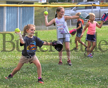 Taylor Caplan, Lucy Kohler and other 8U Saxonburg girls softball players work on their throwing skills Wednesday, part of a two-week clinic put on by little league coaches and volunteers. The girls league regular season was canceled due to the Covid pandemic. Coaches organized the clinic in lieu of a normal season. Seb Foltz/Butler Eagles