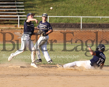Freeport shortstop Joel Hotalski beats a slide from Saxonburg baserunner Angelo DeLeonardis to turn a double play at home Wednesday evening. Seb Foltz/Butler Eagle 06/25/20
