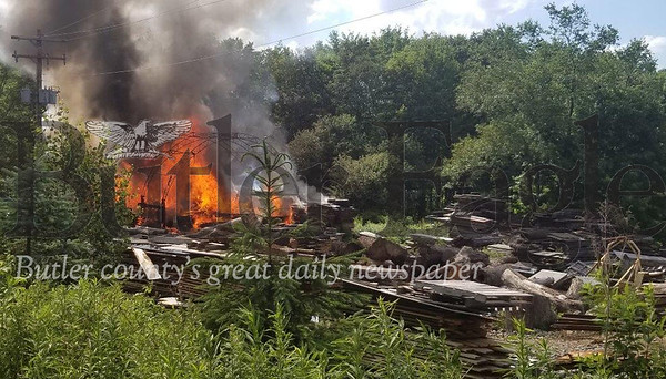 Jim Smith photoFire at Clay Township lumber business.