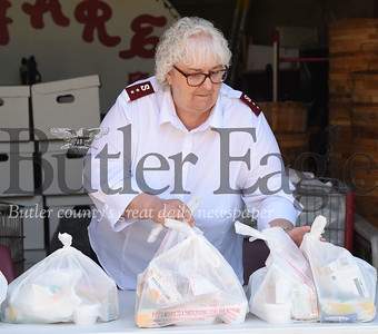 Harold Aughton/Butler Eagle: Captain Darlene Means of the Salvation Army in Butler fills a table with bagged lunches Friday, June 26, 2020.