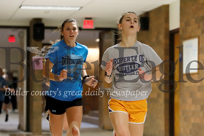 Butler mid-distance runners Krislyn Green (freshman) and Chloe Weiland (sophomore) run laps in the intermediate high school during indoor practice Feb. 11. Seb Foltz/Butler Eagle 02/11/20
