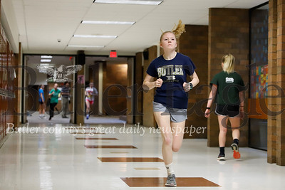 Butler senior distance runner Chelsey Kabel runs laps through the halls of the intermediate high school during indoor track practice. Seb Foltz/Butler Eagle 02/11/20