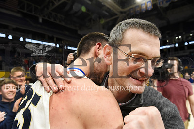 Harold Aughton/Butler Eagle: Butler head coach Matt Clement pumps his fist while embracing senior standout Ethan Morton during the medal ceremony at the Petersen Event Center, Saturday, Feb. 29, 2020.