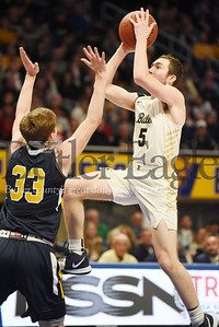 Harold Aughton/Butler Eagle: Mattix Clement goes up for a layup against Mt. Lebanon's #33 during the WPIAL Class 6A championship game at the Petersen Event Center, Saturday, Feb. 29, 2020.