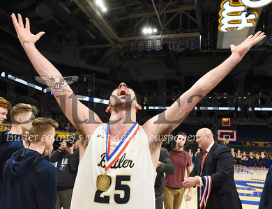 Harold Aughton/Butler Eagle: Butler senior standout Ethan Morton reacts after receiving his championship medal from head coach Matt Clement at the Petersen Event Center Saturday, Feb. 29, 2020.