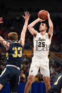 Harold Aughton/Butler Eagle: Butler's Ethan Morton takes a shot over Mt. Lebanon's #33 during the WPIAL Class 6A Championship game at the Petersen Event Center, Saturday, Feb. 29, 2020.